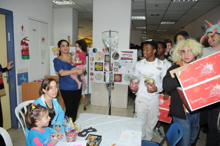 Youth bring AZM goodies to the children in hospital