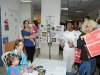 Youth volunteers bring in boxes of goodies